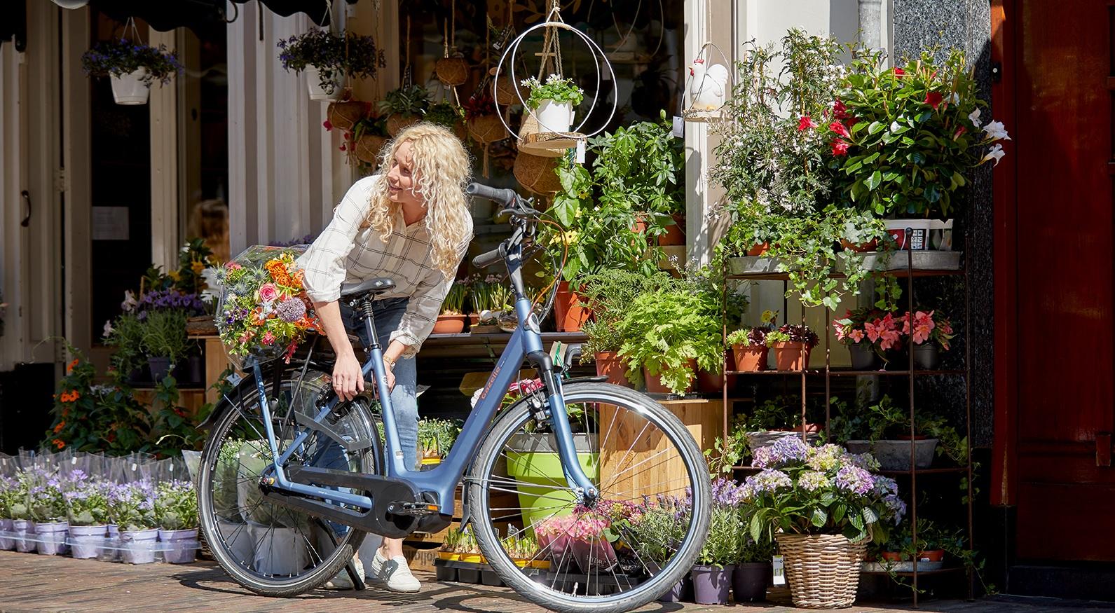 Hoe ver kunt u fietsen met een elektrische fiets?